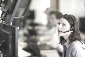 USA, New York, New York City, Female trader at trading desk
