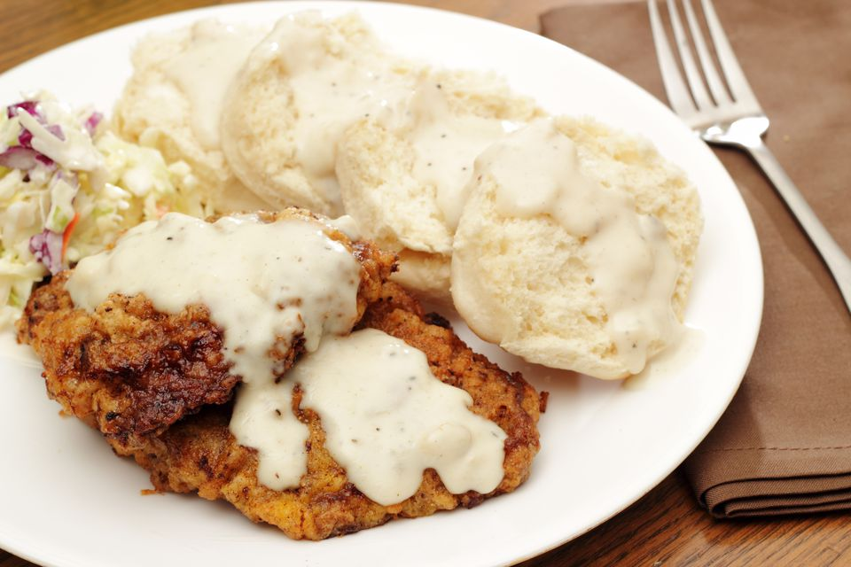 Country-fried steak with mashed potatoes and biscuits.