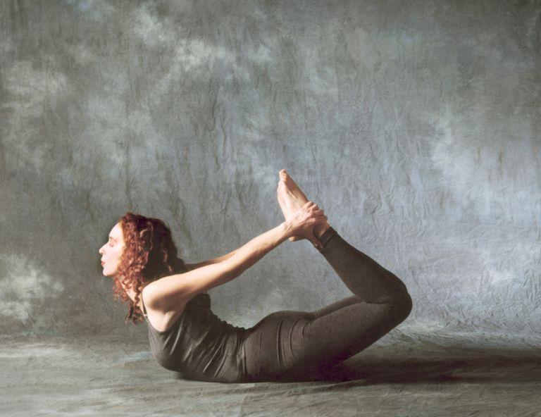 Woman Doing Yoga Bow Pose