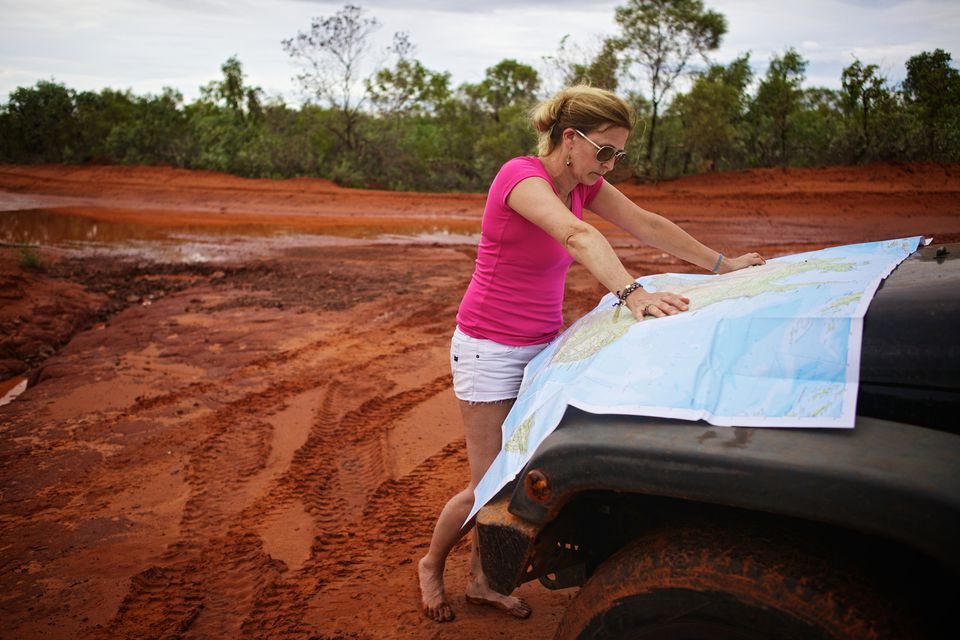 Woman Looking at a Map of Australia
