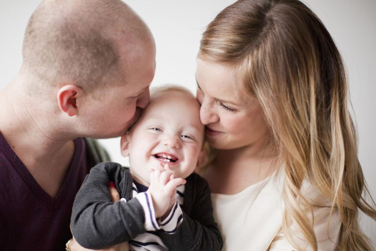 Portrait of happy young family with baby boy (12-17 months).