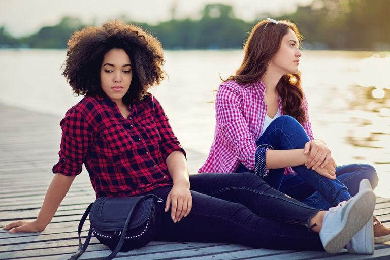 Two girlfriends on the lake with relationship difficulties
