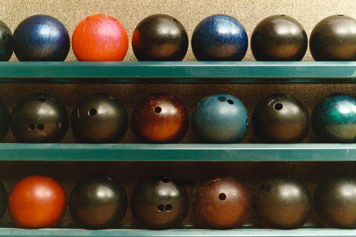 House balls sit on a rack.