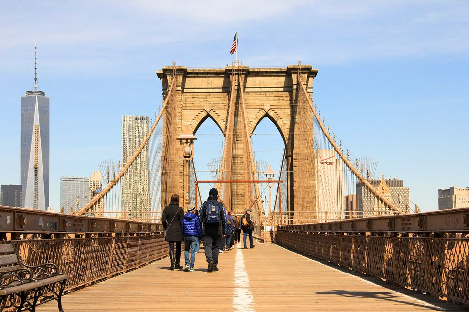 Brooklyn Bridge in New York City with 1 World Trade Center tower in background