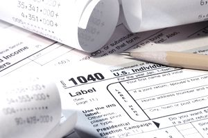 tax papers with adding machine tapes and pencil