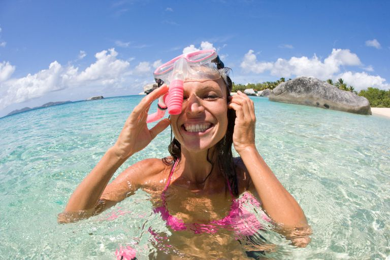 Woman snorkeling in the tropics.