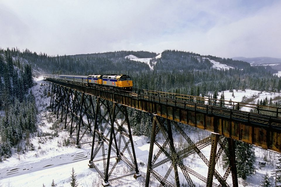 A Via Rail passenger train crossing a steel tressel in the foothills of Alberta Canada.