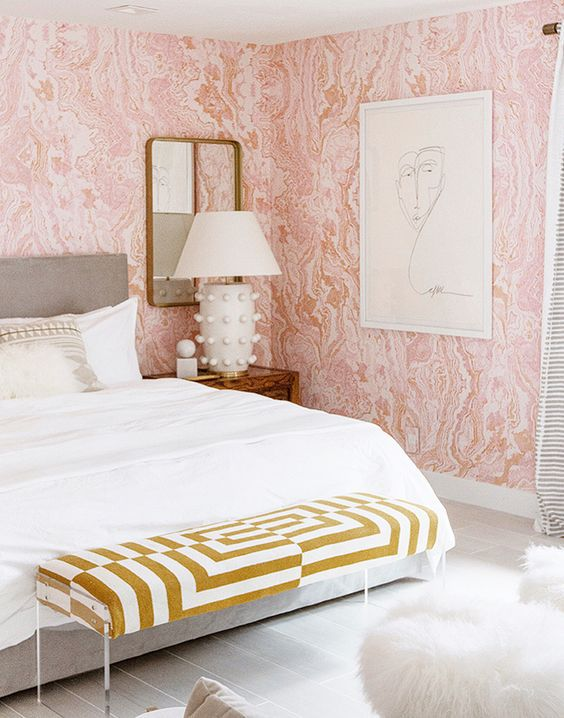 Bedroom with patterned pink wallpaper
