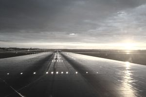 Illuminated runway at dusk