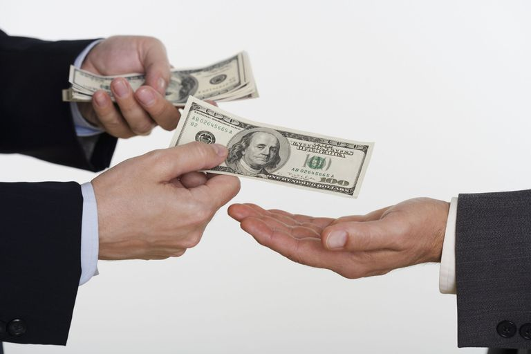 A picture of money swapping hands