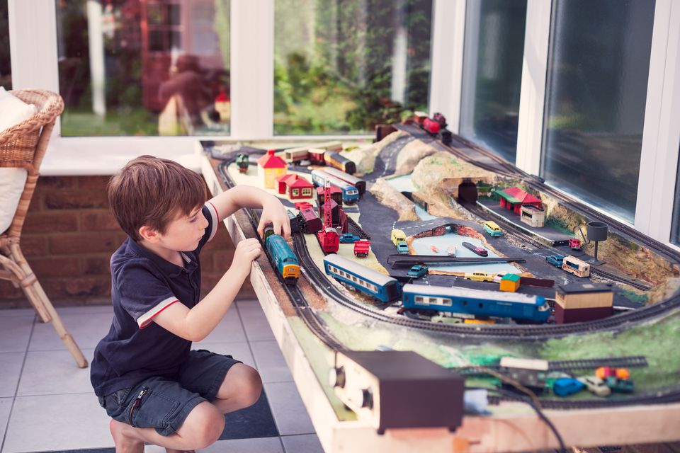 Boy playing with a train set