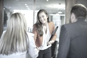 a young woman meeting with business professionals