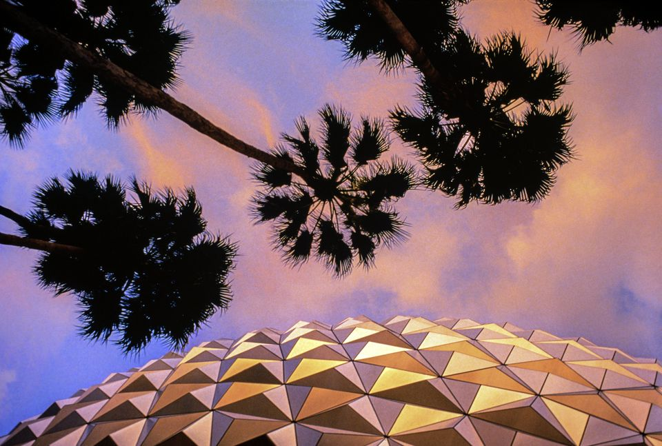 Detail of Spaceship Earth (Epcot Center) a Dusk with Palm Trees