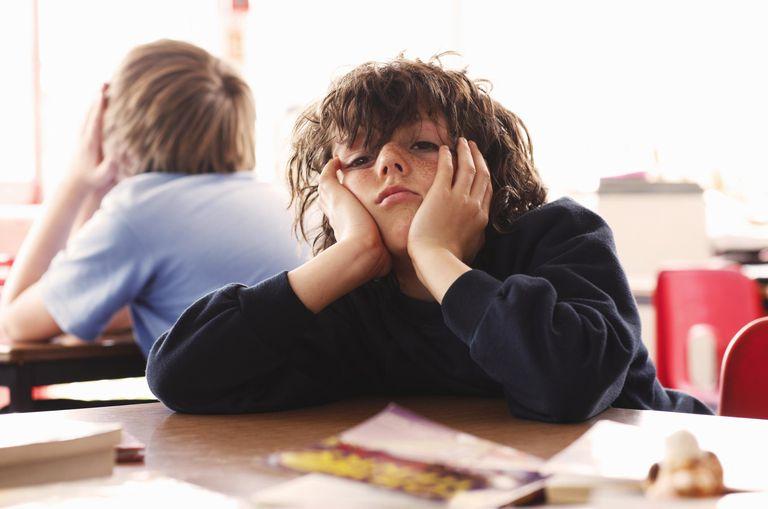 schoolboy looking bored