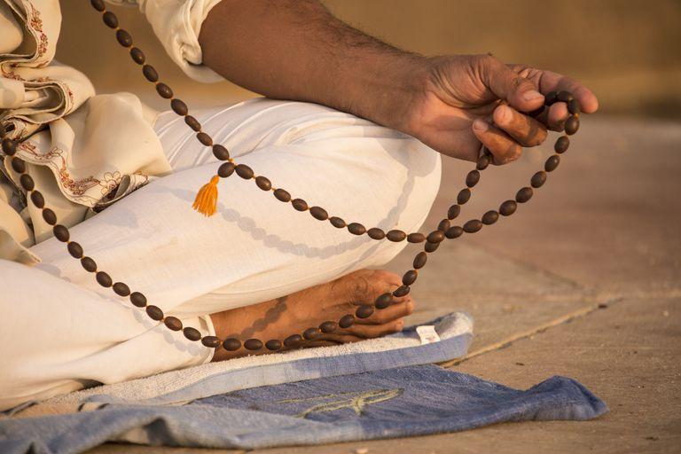 Prayer beads, a man meditating, Varanasi, India