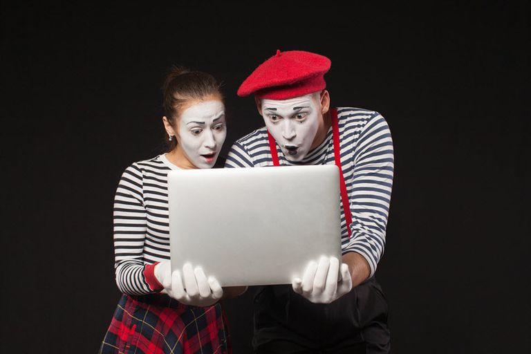 Two MIME actors looking at a computer.