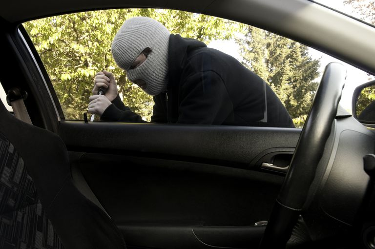 Masked Teenager Breaking into a Car
