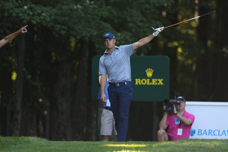 Jordan Spieth signals a wayward drive during a PGA Tour tournament