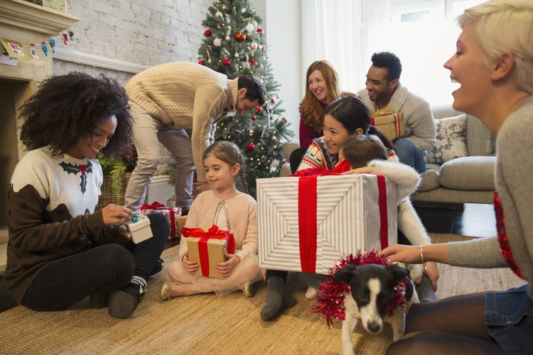 Group of people opening holiday gifts.