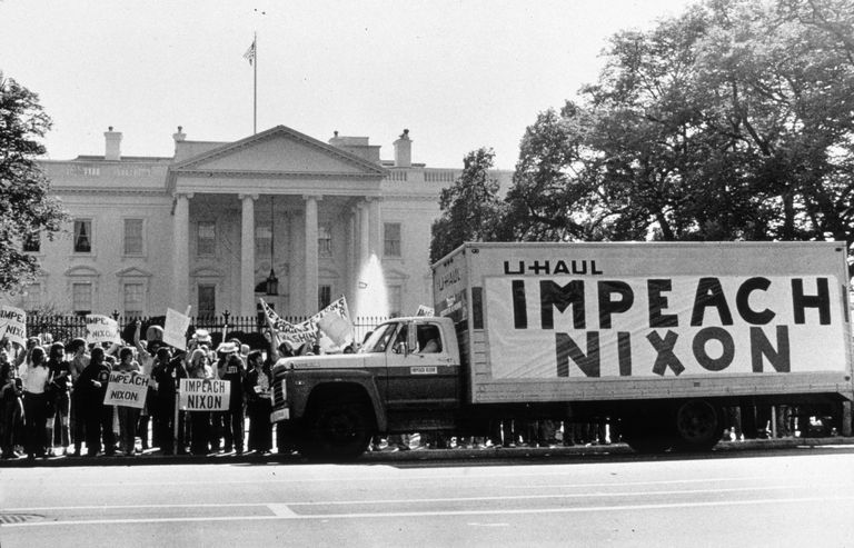 "Old photo of truck with an ""Impeach Nixon"" banner parked outside the White House"