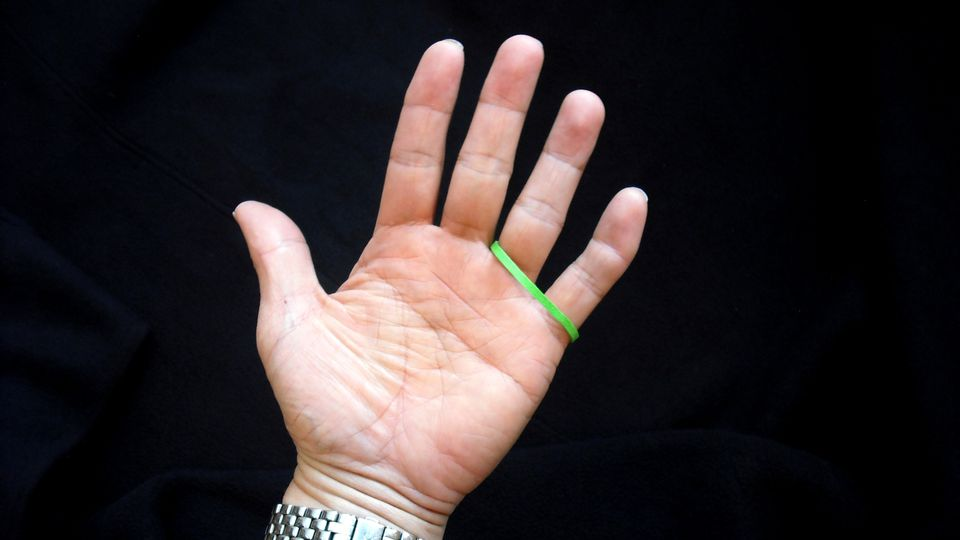 A colorful rubberband in position before the trick