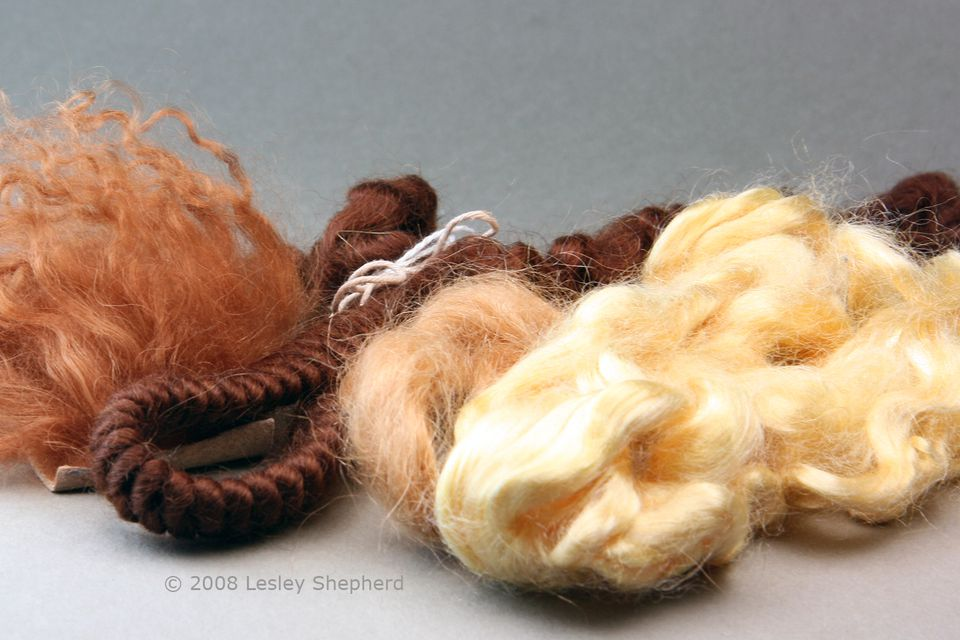 Tibetan lambs wool, braided and stranded mohair, and viscose fibers for miniature doll wigs.