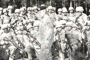 Army Chief of Staff Gen. George Casey Jr. talks to Soldiers with C Company, 1st Battalion, 19th Infantry Regiment, 198th Infantry Brigade, about Sgt. 1st Class Jared Monti, who received the Medal of Honor posthumously, and warrior ethos. Casey visited Fort Benning Oct. 20 to observe Infantry training, view BRAC construction progress and tour the National Infantry Museum for the first time. After the museum tour, Casey re-enlisted five Soldiers and their families in front of the museum's Follow Me Statue.