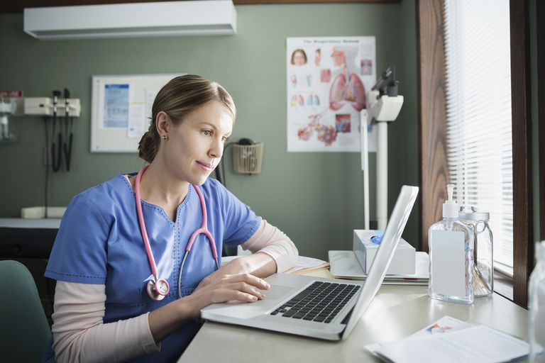 Nurse in front of computer