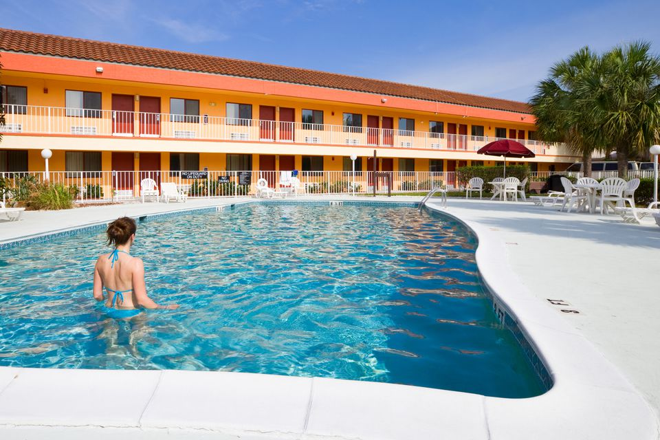 Woman in swimming pool at budget hotel