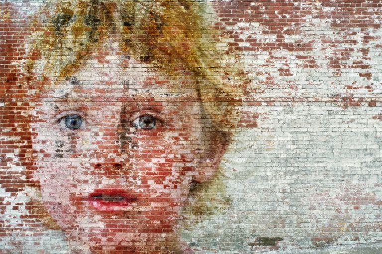 painting of boy on bricks