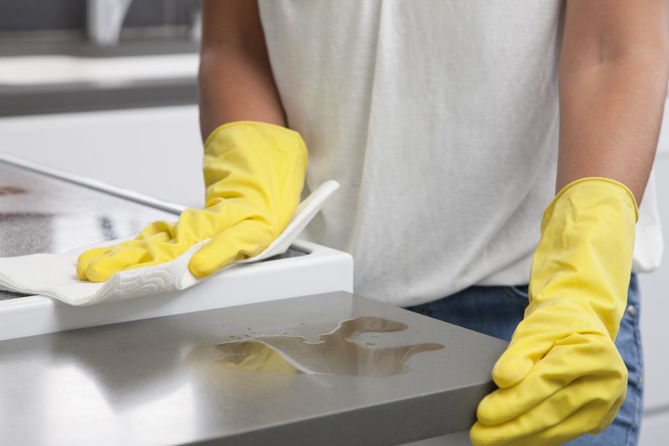 Person wiping countertop