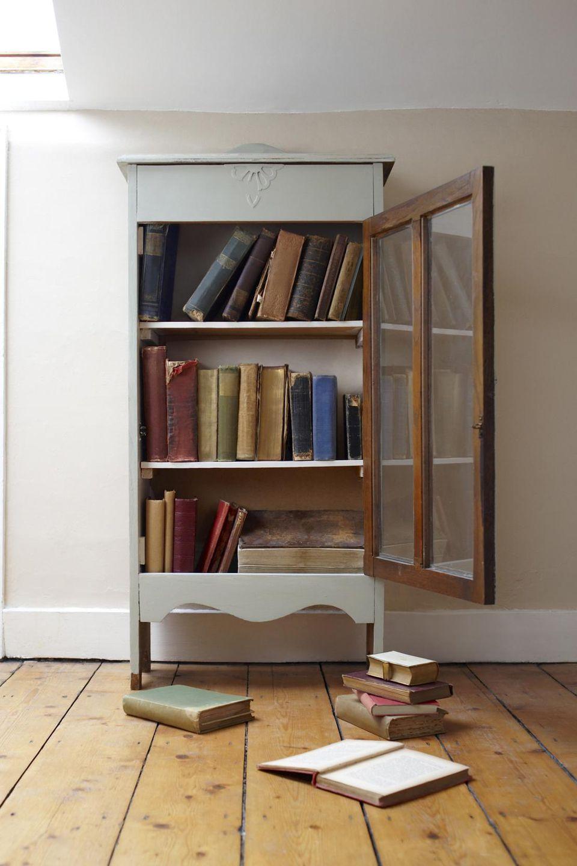 Cupboard full of books.