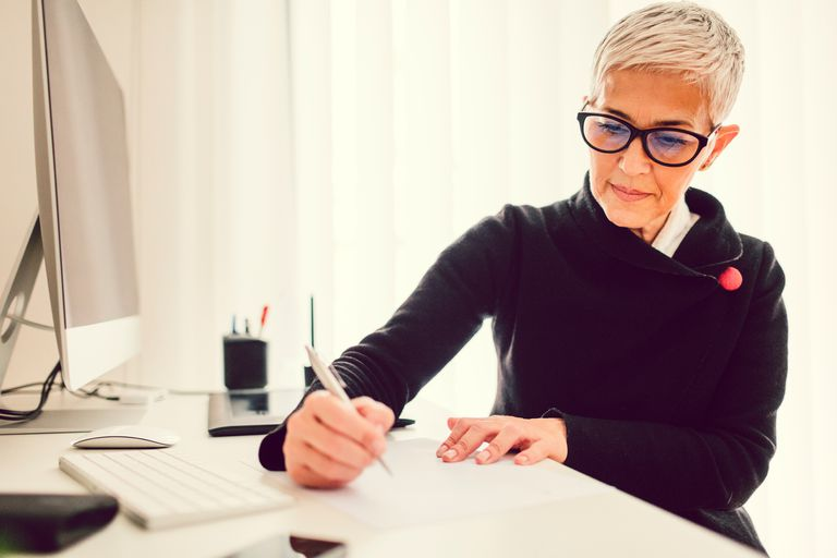 Woman writing letter in home office