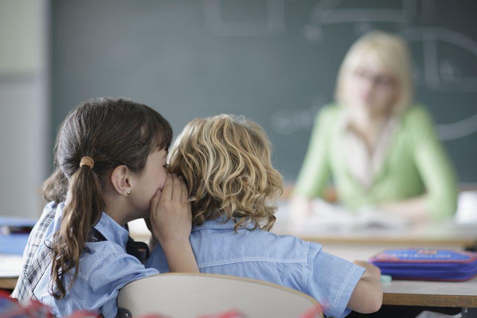 school girl whispering