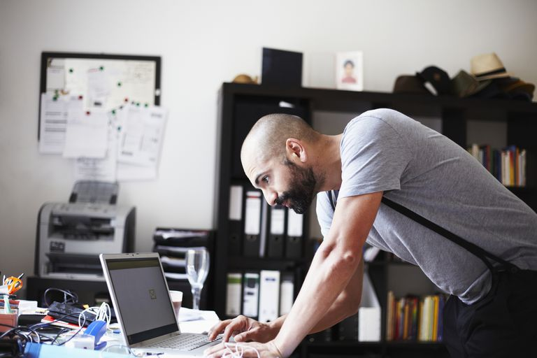 portrait of a young man working at his laptop