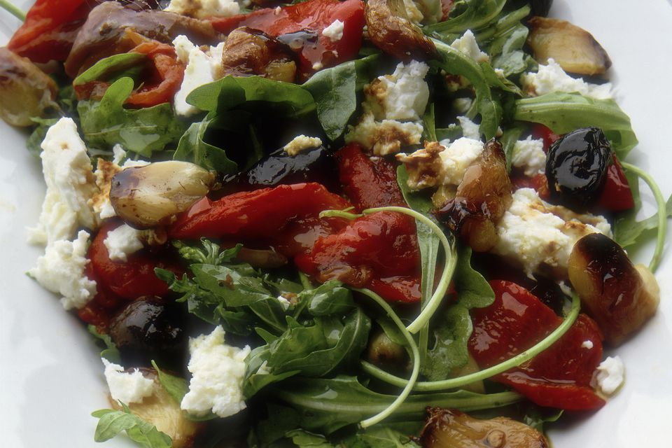 Salad of roasted red pepper and garlic, with rocket, goat's cheese, olives and anchovies and a balsamic dressing