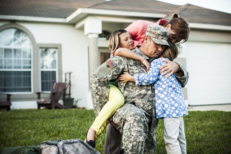 Veteran hugs family