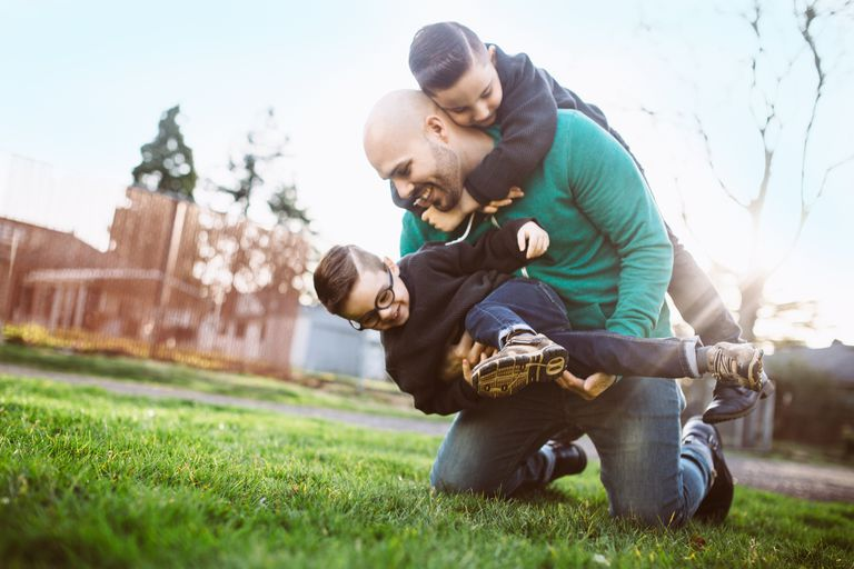 Dad playing with his kids outside