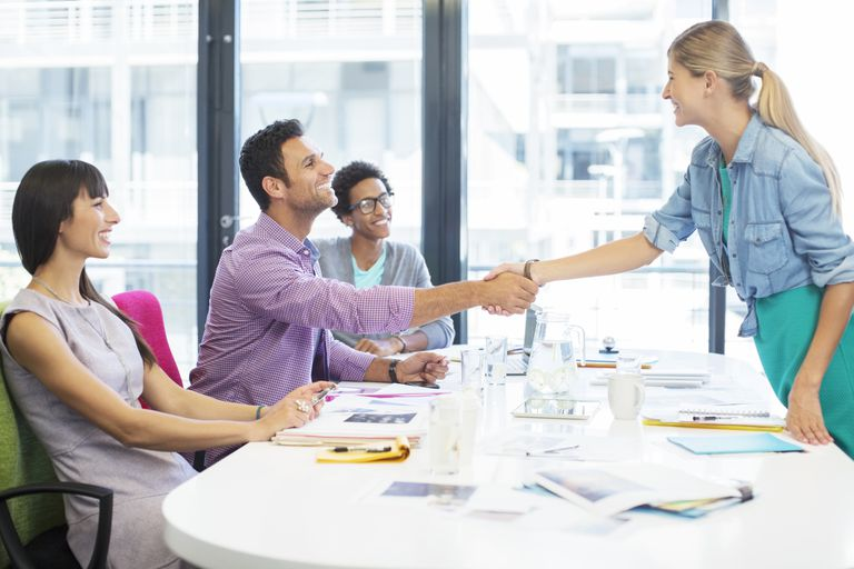 three young business people meeting with woman