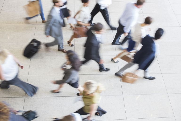 High angle view of business people walking in office on tiled floor