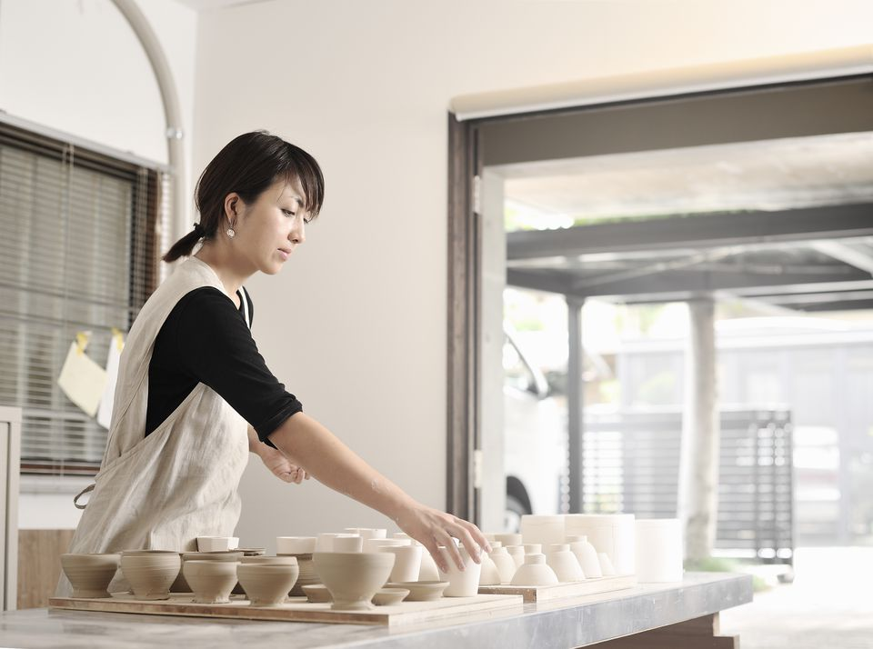 Female Potter working in studio,Kyoto,Japan