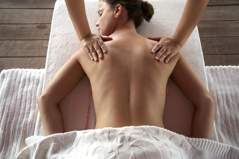 Young woman receiving back massage, elevated view