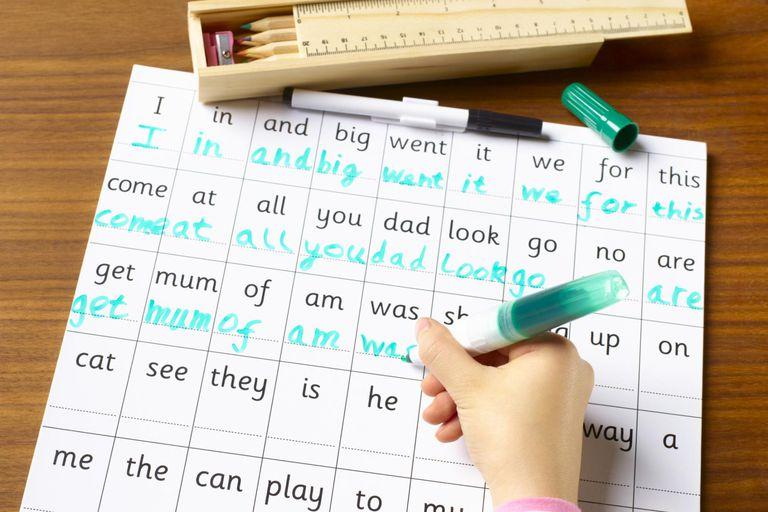 School child age 4-7 practicing handwriting