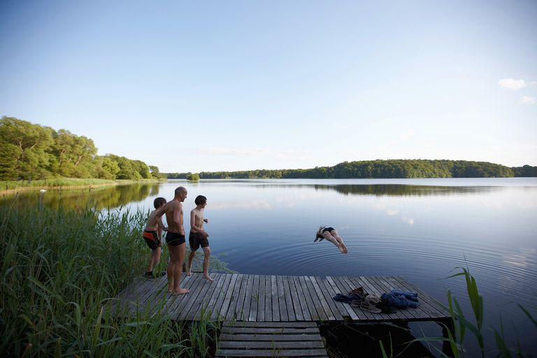 Family swimming in lake