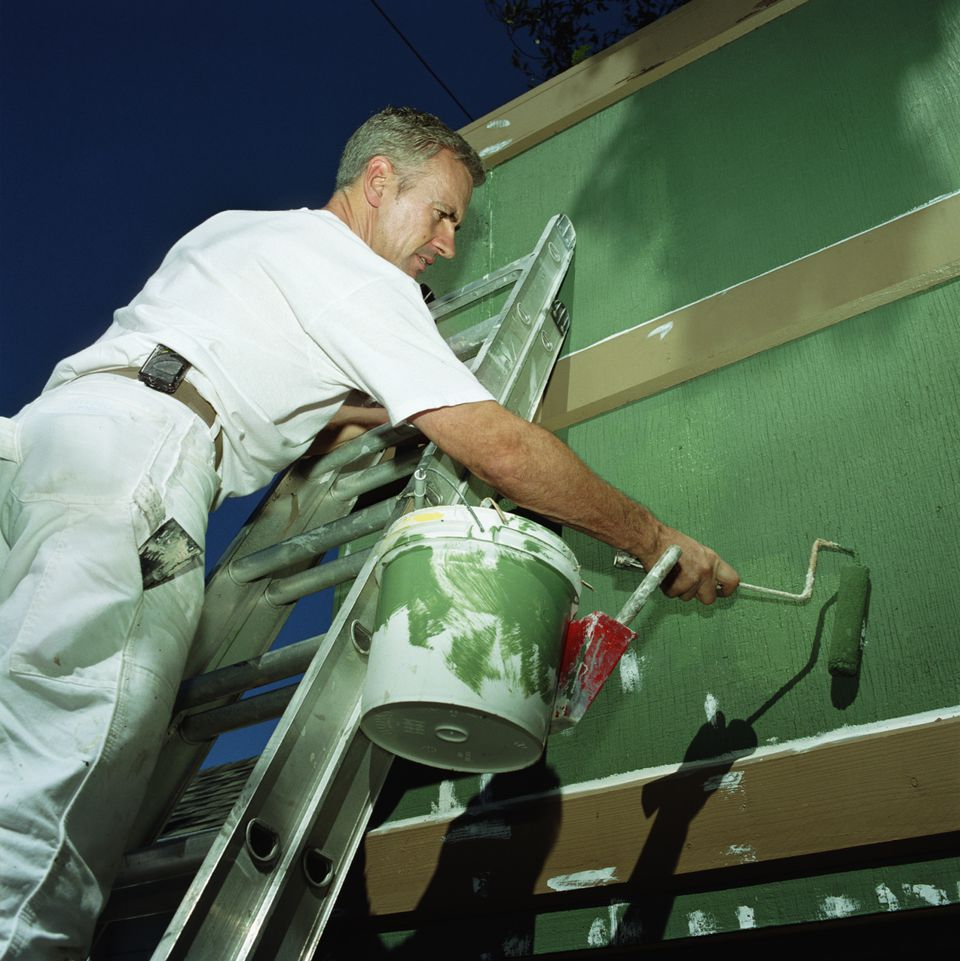Man Painting House Exterior