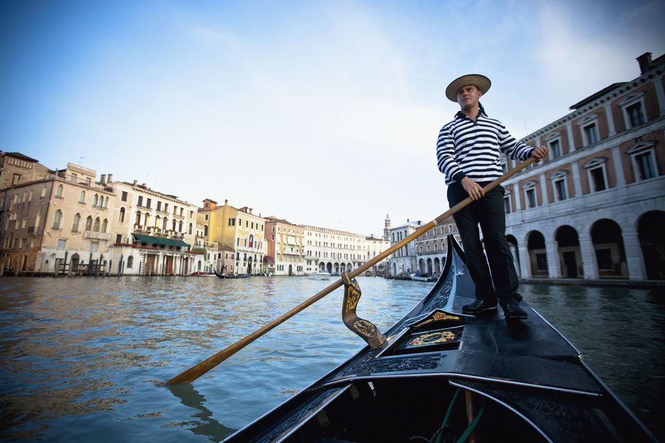 A Gondolier Rowing A Gondola