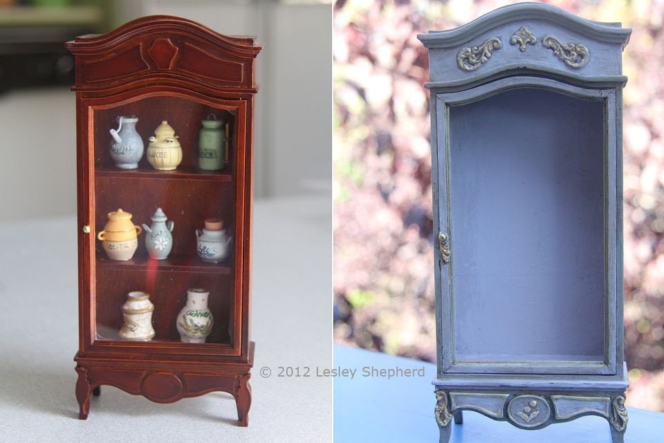 Reworked and refinished dollhouse cabinet compared to its original sad style.