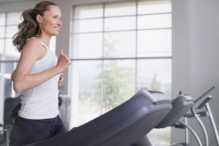 exercise adherence - mom running on treadmill