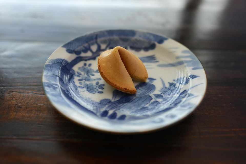 Close-Up Of Fortune Cookie In Plate On Table