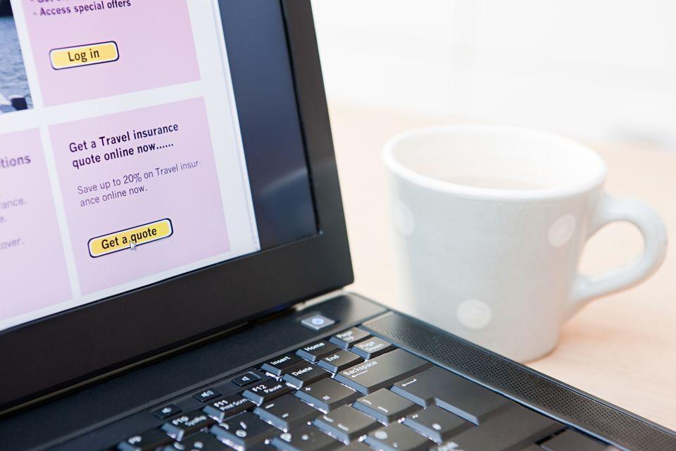 Travel insurance on laptop